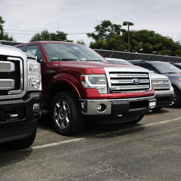 New Ford vehicles occupy the lot at Koons Ford dealership in Fairfax, Virginia, July 24, 2013. Ford Motor Co, maker of the top-selling F-150 pickup tr...