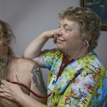 Nurse practitioner Mary Fey listens to the heart beat of patient Jef Jalof, of Falls Creek, Or., at Dexter Clinic run by Peace Health, in Dexter., Or....