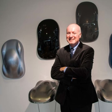 BASF color chief Paul Czornij with samples of paint colors for cars likely to be popular over the next few years.