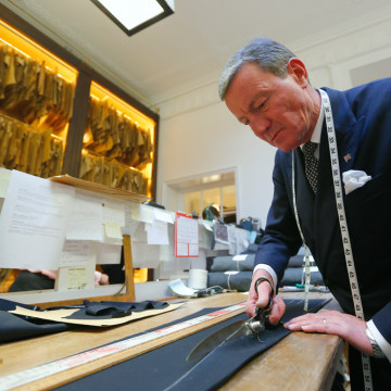 Head trouser cutter John Malone cuts cloth for a suit at bespoke Savile Row tailors Anderson & Sheppard in central London February 14, 2013. Anderson ...