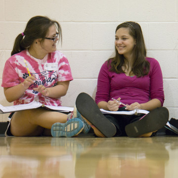 At left, Rachel Mast, 14, in training with other students at her middle school to become student ambassadors to incoming sixth graders on Aug. 6, 2013...