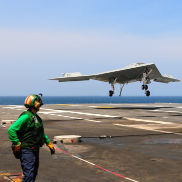 130710-N-TB177-135                 ATLANTIC OCEAN (July 10, 2013) An X-47B Unmanned Combat Air System (UCAS) demonstrator completes an arrested landing on the flight ...
