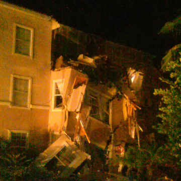 A building housing vacationers at a Florida resort collapses early Monday after a sinkhole opened up.