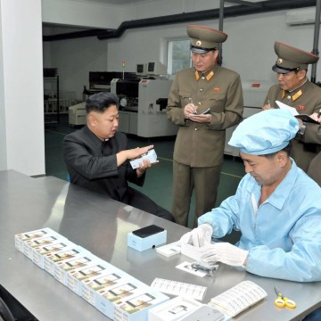 North Korean leader Kim Jong-Un visits the May 11 Factory in this undated photo released by North Korea's Korean Central News Agency (KCNA) in Pyongya...
