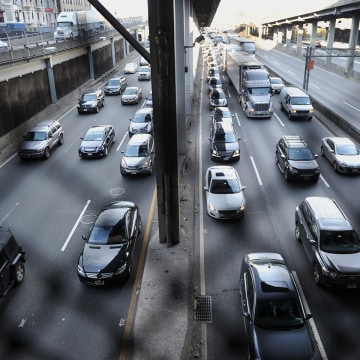 Heavy traffic exits the George Washington Bridge as morning commuters drive into Manhattan.