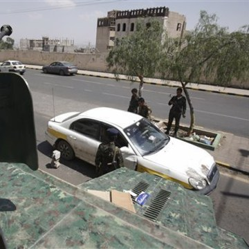This Aug. 10, 2013 file photo shows Yemeni soldiers inspecting a car at a checkpoint on a street leading to the U.S. and British embassies in Sanaa, Yemen. In secretive chat rooms and on encrypted Internet message boards, al-Qaida fighters have been planning and coordinating attacks _ including a threatened if vague plot that U.S. intelligence officials say closed 19 embassies across Africa and the Middle East for more than a week.