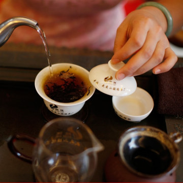 A woman brews tea at tea room on May 11, 2012 in Wuyishan, Fujian province, southeastern China. Wuyi Mountains is renowned for producing top quality t...