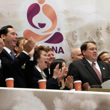 Executives and guests of Teavana, a chain of retail tea shops, applaud as CEO Andrew T. Mack, second from right, rings the New York Stock Exchange ope...