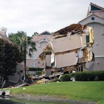 A section of the Summer Bay Resort lies collapsed after a large sinkhole opened on the property's grounds in Clermont, Fla. on Aug. 12.