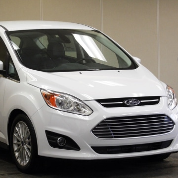 A 2013 Ford C-MAX Energi is on display during a news conference to mark the official production launch of the vehicle at the Michigan Assembly Plant i...