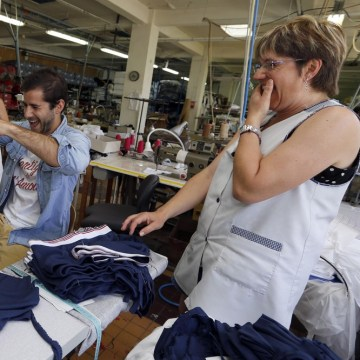 "Guillaume Gibault, 27, center, founder and designer of Le Slip Francais men's underwear brand, works on a sample. Gibault offers a ""100 percent Made-i..."