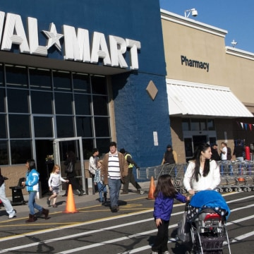 Customers walk outside a Walmart store in this  November 17, 2012 file photo in Norwalk, Connecticut.  US retail behemoth Walmart on June 7, 20...