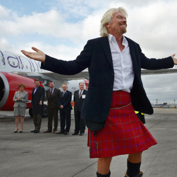 EDINBURGH, SCOTLAND - APRIL 08:  Sir Richard Branson arrives in Edinburgh Airport wearing a Harris Tweed Kilt on April 8, 2013 in Edinburgh, Scotland....