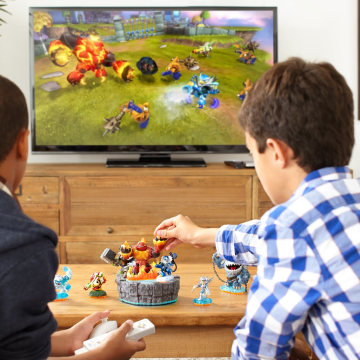 """Skylanders"" was the first video game to popularize using toys as part of the actual gameplay. By placing action figures on a small plastic ""portal of power"" that plugs into a PC of console, players could see the action figures appear onscreen and take part in the game's action."