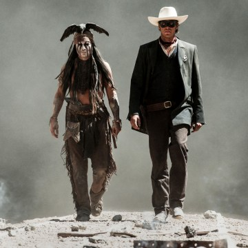 This undated publicity photo released by Disney and Jerry Bruckheimer, Inc. shows Johnny Depp, left, as Tonto, and Armie Hammer, as The Lone Ranger, i...