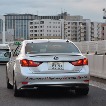 "This photo taken on October 10, 2013 shows Japanese auto giant Toyota Motor demonstrating the advanced driving support system ""Automated Highway Drivi..."