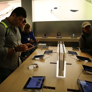 NEW YORK, NY - NOVEMBER 01: People try the new Apple iPad Air at the Apple Store on November 1, 2013 in New York City. The new iPad, the fifth generat...