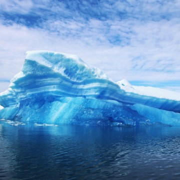 IMAGE: Calved icebergs from the nearby Twin Glaciers are seen floating on the water in Qaqortoq, Greenland.