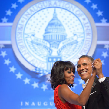 US President Barack Obama and First Lady Michelle Obama dance during the Inaugural Ball at the Walter E. Washington Convention Center on January 21, 2013