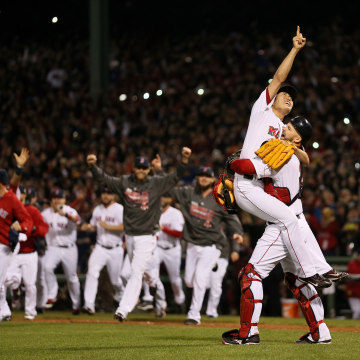 BOSTON, MA - OCTOBER 30:  Koji Uehara #19 of the Boston Red Sox celebrates with David Ross #3 after defeating the St. Louis Cardinals 6-1 in Game Six.