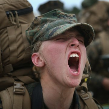 CAMP LEJEUNE, NC - FEBRUARY 22: Pvt. Megan Garris of Severna Park, Maryland responds to her instructor's command for a head count following a 10 km hike.