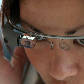 SAN FRANCISCO, CA - MAY 17:  An attendee tries Google Glass during the Google I/O developer conference on May 17, 2013 in San Francisco, California.