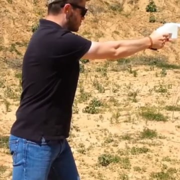 Cody Wilson, founder of Defense Distributed, fires a 3D-printed handgun known as the Liberator.