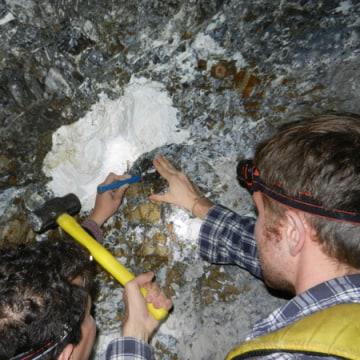 Graduate students measure a magnesite nodule