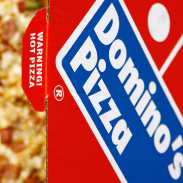 A Domino's Pizza is pictured in its box in central London, February 15, 2009.  Britain's biggest pizza delivery chain Domino's Pizza reported a 25 per...