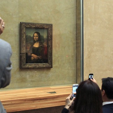 FILE: Guests take snapshots of Mona Lisa, during an event to unveil the new lighting of Leonardo da Vinci's painting Mona Lisa, also known as La Jocon...