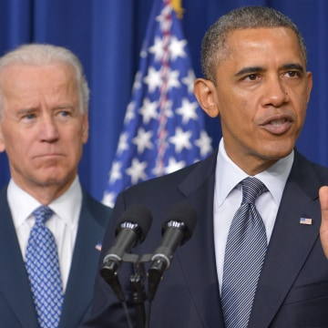 President Barack Obama speaks on proposals to reduce gun violence as Vice President Joe Biden watches on Jan. 16, 2013 in the South Court Auditorium o...