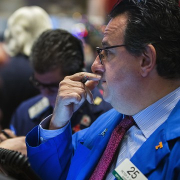 Stocks soared on the Federal Reserve's announcement it would cut back on its economic stimulus program starting next month.