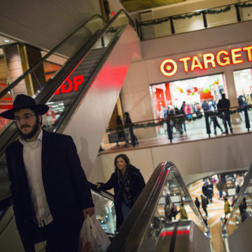 Shoppers are seen at a Target store during Black Friday sales in the Brooklyn borough of New York, November 29, 2013.
