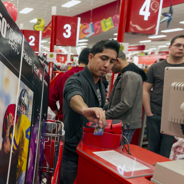A customer swipes his credit card to pay for a television doorbuster deal at a Target store in Burbank, Calif., on Nov. 22, 2012.
