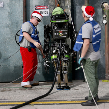 HOMESTEAD, FL - DECEMBER 21:  Chris Roberts (L) and Robert Hung prepare their robot from team HKU, the University of Hong Kong, for a challenge during...