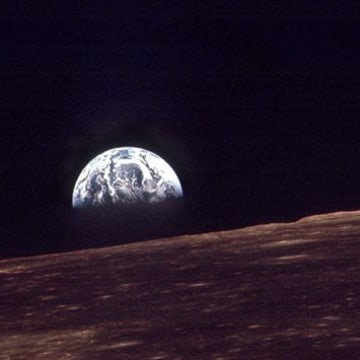 IMAGE: Earth shines over the horizon of the moon in as seen by the astronauts on Apollo 8