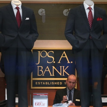 An employee works inside a Jos. A. Bank retail store on December 5, 2013 in San Francisco, California.