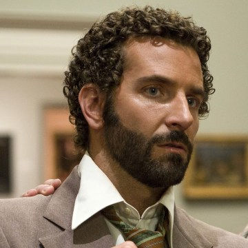 "This film image released by Sony Pictures shows Bradley Cooper, left, and Christian Bale in a scene from ""American Hustle."" The New York Film Critics ..."