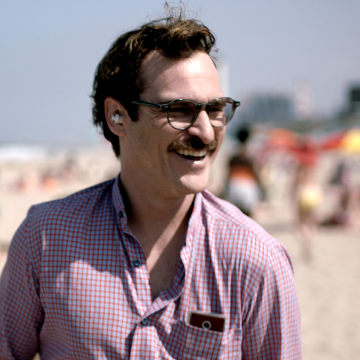 """This image released by Warner Bros. Pictures shows Joaquin Phoenix in a scene from """"Her."""""""