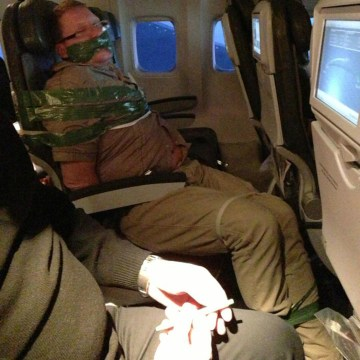 Image: Unruly passenger taped to seat