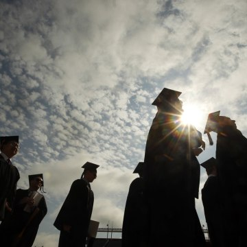 Graduating students arrive for Commencement Exercises at Boston College in Boston, Massachusetts May 20, 2013.