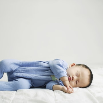 A baby's head tends to roll to the side when he sleeps, which can lead to a flat spot over time.
