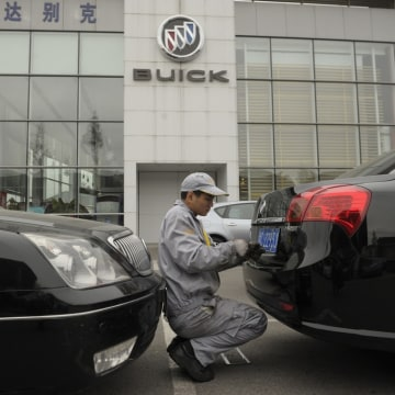 A mechanic works on a Buick at a General Motors dealership in Shanghai in 2011. China is now General Motors' biggest market, selling more vehicles tha...