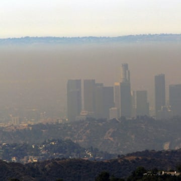 A thick band of haze shrouds downtown Los Angeles on Monday July 9, 2012. Forecasters warned that heat, combined with very low humidity levels, will e...