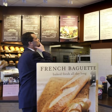 Hmm, maybe we'll try again later. In this March 8, 2010 file photo, a customer reviews the sandwich board at the Panera store in Brookline, Mass.