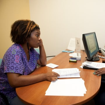 MARIETTA, GA:  Sharonton Taylor, 27, (left) meets with case manager Alysha Sturgeon at The Center for Family Resources in Marietta, Ga on Friday, July...