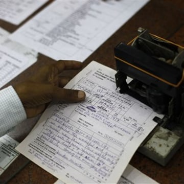 An Indian telegraph employee processes a telegram on the last day of the 163-year-old service at the central telegraph office in Mumbai, India, Sunday...