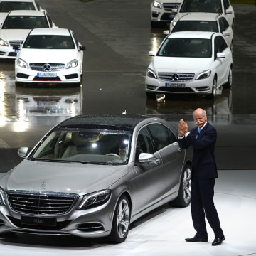 CEO of Daimler Dieter Zetsche stands next to the new S-Class Mercedes presented in Hamburg, Germany, Wednesday, May 15, 2013. The new Mercedes is supp...