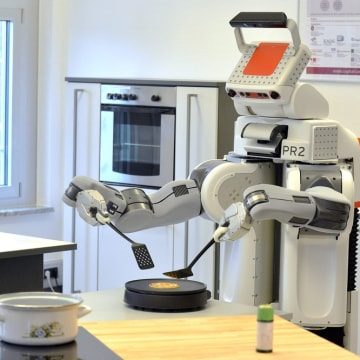 epa03603034 Robot 'PR2' flips a pancake in a laboratory kitchen of the Institute for Artificial Intelligence (IAI) at the Institute of Informatics and...