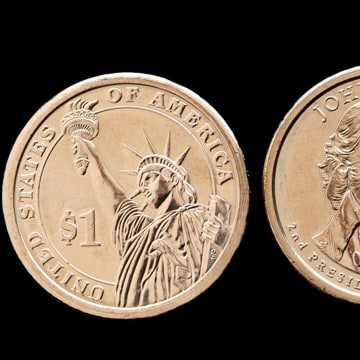 This undated photo provided by the U.S. Mint shows the front, right, and back of the President John Adams presidential $1 coin. The second dollar coin...